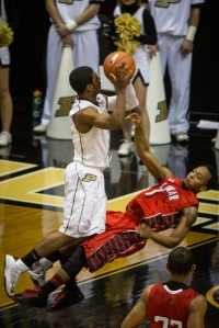 His brother Ronnie Johnson with a charge late in the first half