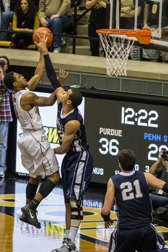 Terone Johnson getting fouled on his way to the hoop