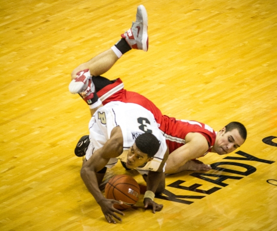Ronnie Johnson battles Aaron Craft for the ball early in the game