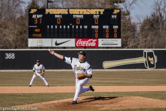Brad Schreiber throws the first pitch in Alexander Field history